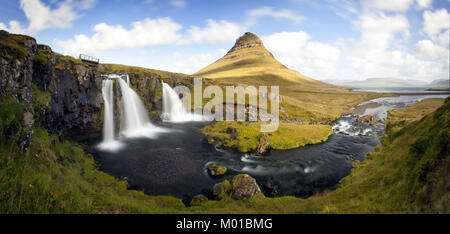 Panorama of the Kirkjufell waterfall with the famous mountain in the background. - Stock Photo