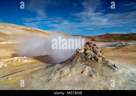 Steam coming from a fumarole or volcanic vents at Hverarond in Iceland. - Stock Photo
