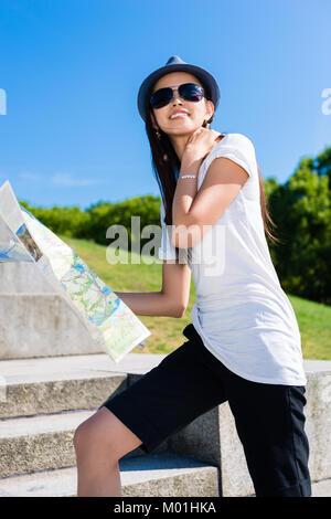Happy young Asian tourist climbing stairs - Stock Photo