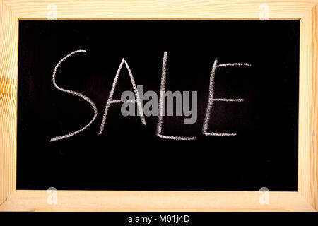 Blackboard with sale written on in white chalk - Stock Photo