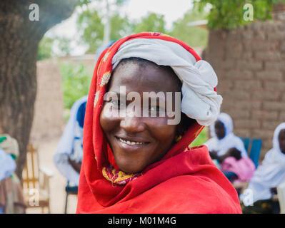 Portrait of an african muslim woman smiling, Ouagadougou, Burkina Faso. - Stock Photo