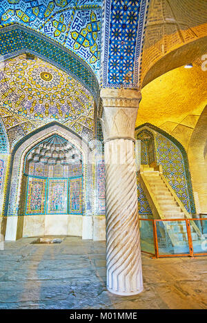 SHIRAZ, IRAN - OCTOBER 12, 2017: The old Vakil Mosque constructed of brick and contains stone details and rich tiled - Stock Photo