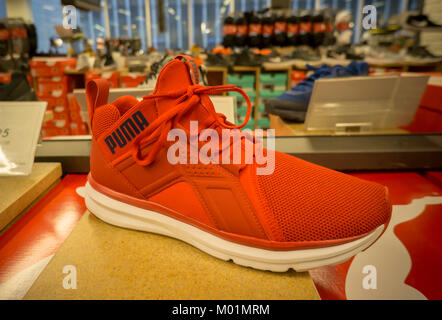 A Puma brand sneaker on display in a shoe store in New York on Friday, January 12, 2018. The French company Kering - Stock Photo