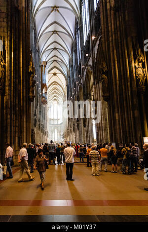 COLOGNE, GERMANY - JUNE 27, 2010: tourists indoor of Cologne Cathedral. The Cathedral is Germany's most visited - Stock Photo