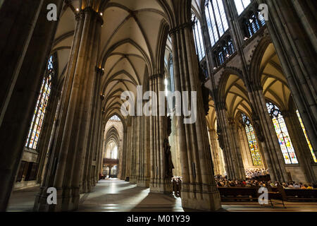 COLOGNE, GERMANY - JUNE 27, 2010: people in church service in Cologne Cathedral. The Cathedral is Germany's most - Stock Photo