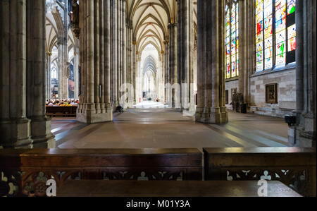 COLOGNE, GERMANY - JUNE 27, 2010: visitors inside of Cologne Cathedral. The Cathedral is Germany's most visited - Stock Photo