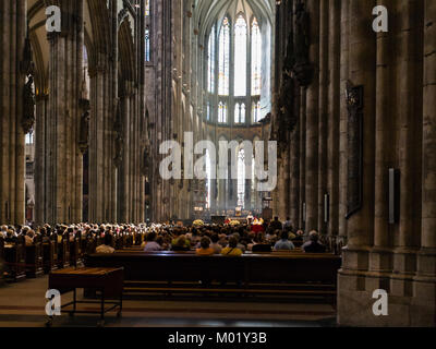 COLOGNE, GERMANY - JUNE 27, 2010: visitors in church service in Cologne Cathedral. The Cathedral is Germany's most - Stock Photo