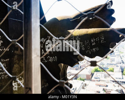 COLOGNE, GERMANY - JUNE 27, 2010: scribbled statue in outdoor gallery on roof of Cologne Cathedral. The Cathedral - Stock Photo