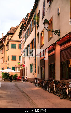 STRASBOURG, FRANCE - JULY 11, 2010: cook near restaurant on street Rue des Tailleurs de Pierre at sunset in Strasbourg. - Stock Photo