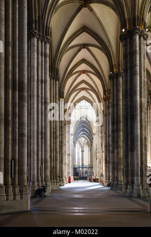 COLOGNE, GERMANY - JUNE 27, 2010: people in nave of Cologne Cathedral. The Cathedral is Germany's most visited landmark, - Stock Photo