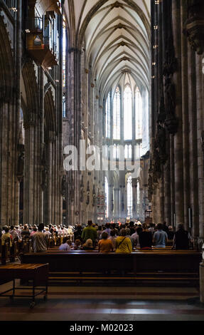 COLOGNE, GERMANY - JUNE 27, 2010: visitors in divine worship in Cologne Cathedral. The Cathedral is Germany's most - Stock Photo
