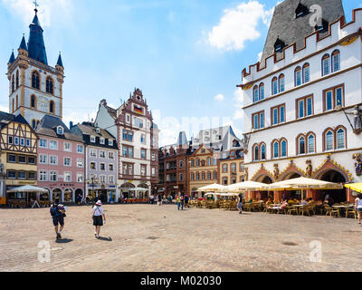 TRIER, GERMANY - JUNE 28, 2010: tourists on Hauptmarkt (Main Market square) and view of St Gangolf Church in Trier - Stock Photo
