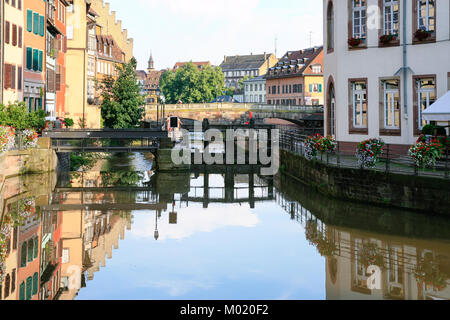 STRASBOURG, FRANCE - JULY 11, 2010: people on Quai des Moulins of Ill river in Petite France quarter in Strasbourg - Stock Photo