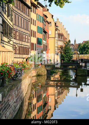 STRASBOURG, FRANCE - JULY 11, 2010: people in Petite France quarter on Ill river island in Strasbourg city in summer. - Stock Photo