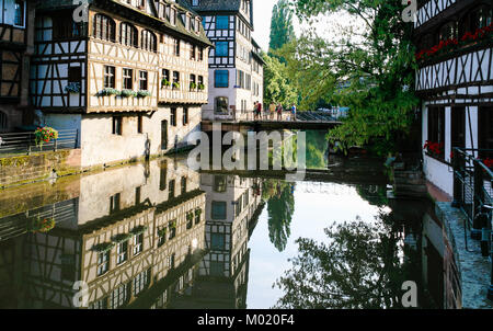 STRASBOURG, FRANCE - JULY 11, 2010: people on bridge over of Ill river in Petite France quarter in Strasbourg city. - Stock Photo