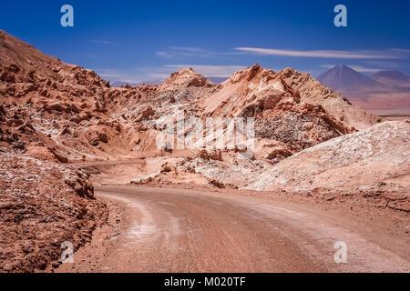 Road through the famous Valle the la Luna near San Pedro de Atacama in Chile - Stock Photo