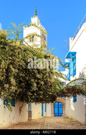 Mosque in the white-blue city of Sidi Bou Said, Tunisia. Eastern fairy tale with a French charm. - Stock Photo