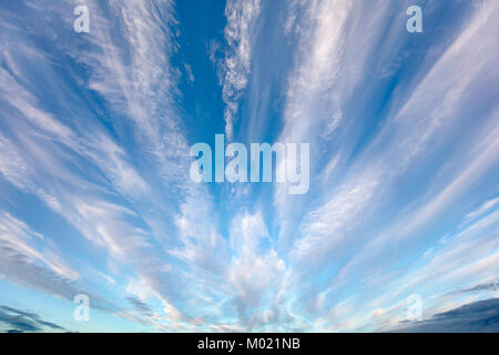 Wide angle view of Altostratus undulatus wave  clouds in a rarely seen undulating fan-shape accompanied by some - Stock Photo