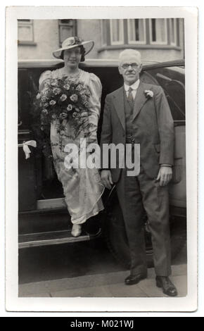 Beryl Johnson on her wedding day, being taken to the church by her uncle Walter Willatt, 1938.  She was married - Stock Photo