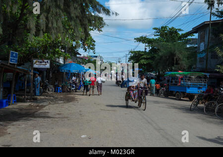 Mrauk-u, Rakhine State / Myanmar - October 19 2016: Everyday main street life scene - Stock Photo
