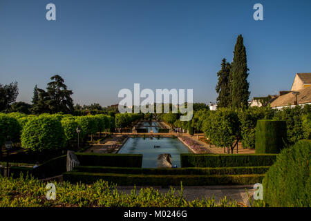 CORDOBA, ANDALUSIA / SPAIN - OCTOBER 14 2017: GREEN PARK WITH WATER AND BLUE SKY - Stock Photo