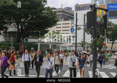 Shinjuku, Tokyo, Japan, Sept 24 2017 People walking at crossing in front of JR Shinjuku Station West Gate on Sunday - Stock Photo