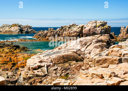 travel to France - rocky coasline of Ile-de-Brehat island in Cotes-d'Armor department of Brittany in summer sunny - Stock Photo