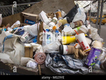 The amount of garbage created daily due to one use coffee and other beverage cups is astronomical. Garbage cans, - Stock Photo