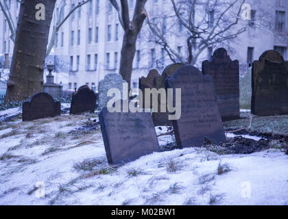 Old 18th century gravestones at Saint Paul's Chapel, Trinity Church in lower Manhattan. - Stock Photo