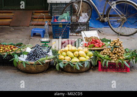 Hanoi,Vietnam - October 31,2017 : Various types of fruits selling from the traditional hanging baskets can found - Stock Photo