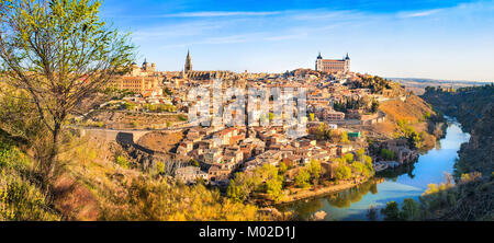 Panoramic view of the historic city of Toledo with river Tajo at sunset in Castile-La Mancha, Spain