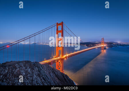 Classic panoramic view of famous Golden Gate Bridge seen from famous Battery Spencer viewpoint in beautiful post sunset twilight at dusk, California