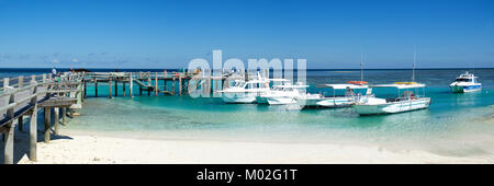 Boats moored at Heron Island on the southern end of the Great Barrier Reef, Queensland, Australia - Stock Photo