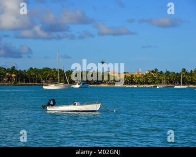 Trou-aux-Biche, Mauritius - Jan 9, 2017. Small boats docking on beautiful sea at spring in Trou-aux-Biches, Mauritius - Stock Photo
