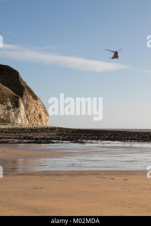 Coastguard helicopter at South Landing on the East Yorkshire coast - Stock Photo