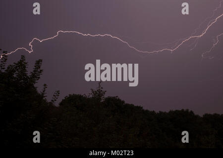Fork lightning during a thunderstorm in West Yorkshire - Stock Photo