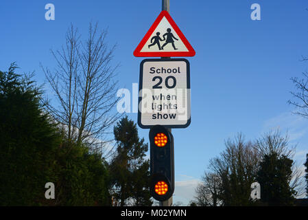 warning lights and sign for drivers of school ahead united kingdom - Stock Photo