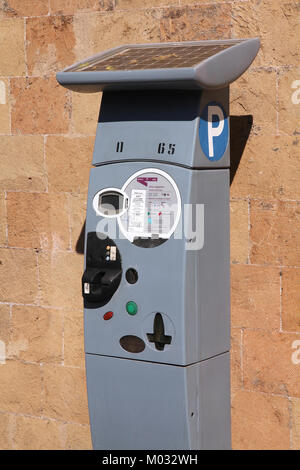 ROME - APRIL 9: Parking meter on April 9, 2012 in Rome, Italy. Rome suffers from traffic congestion and authorities - Stock Photo