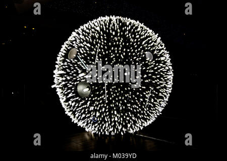 Artificial Moon, a lighting installation built from a thousand of energy-efficient fluorescent bulbs. Designed by - Stock Photo
