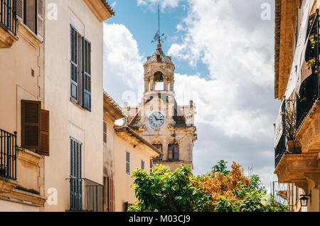 Architecture of Majorca. The tower with big clock of City town hall in Old Town of Alcudia, Mallorca, Balearic island, - Stock Photo