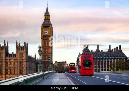 LONDON, UK - NOVEMBER 03, 2012:  Red Double Decker buses move along the Westminster Bridge with Elizabeth Tower - Stock Photo