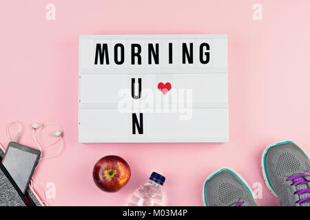 Motivation text MORNING RUN and sports accessories - Stock Photo