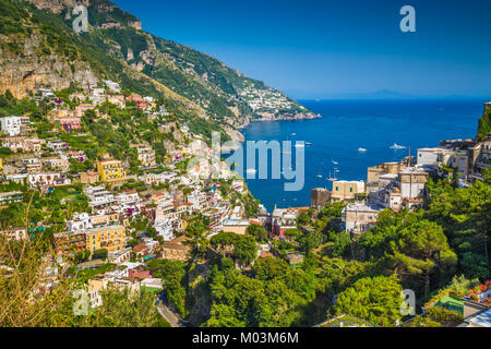 Scenic picture-postcard view of the town of Positano at famous Amalfi Coast with Gulf of Salerno in beautiful evening - Stock Photo