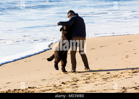 Bournemouth, Dorset, UK. 18th Jan, 2018. UK weather: a lovely sunny day at Bournemouth beach. Man 'dancing with' - Stock Photo