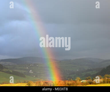 Aberystwyth, UK. 18th Jan, 2018. UK Weather - Bright rainbow appears over the Cambrian Mountains near Aberystwyth, - Stock Photo