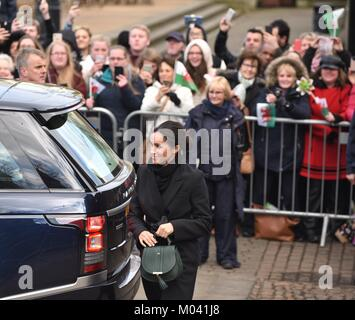 Cardiff, Wales, UK. 18th January 2018. Meghan steps out sporting a long black coat by Stella McCartney and a green - Stock Photo