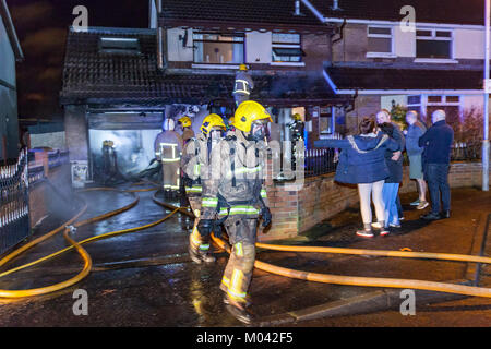Belfast, UK. 18th Jan, 2018. House badly damaged in major blaze in West Belfast. Several Fire engine along with - Stock Photo