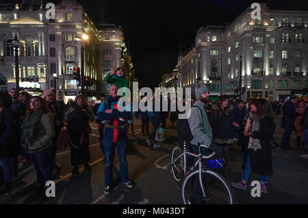 London, UK. 18th Jan, 2018. People in Piccadilly Circus during the 2018 Lumiere London festival in London. Photo - Stock Photo