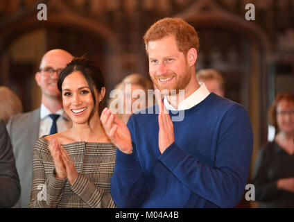 Prince Harry and Meghan Markle watch a performace during a visit to Cardiff Castle. - Stock Photo