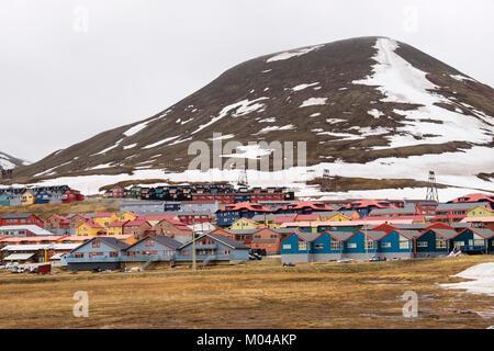 Colourful wooden residential houses in summer in old mining town of Longyearbyen, Spitsbergen Island, Svalbard, - Stock Photo